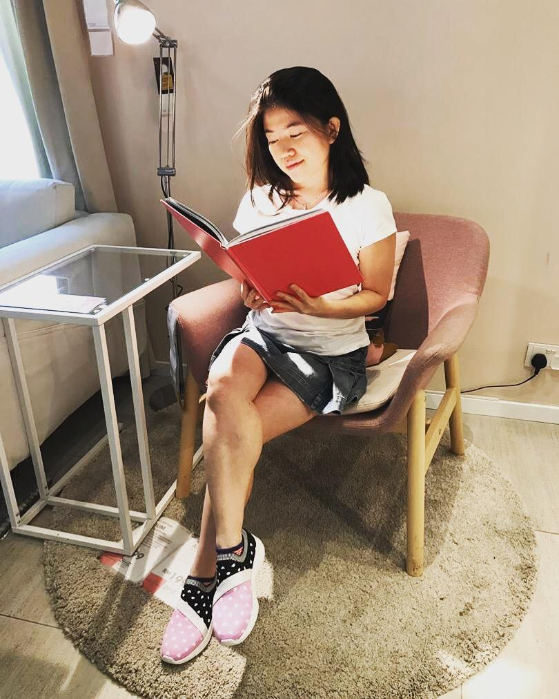wanderlust girl reading a book with skechers kids shoes