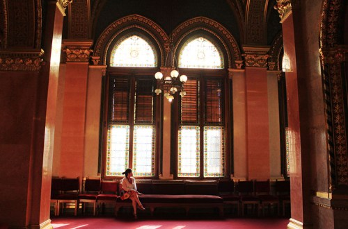 a girl named Clara sitting inside Hungarian Parliament Building morning tour
