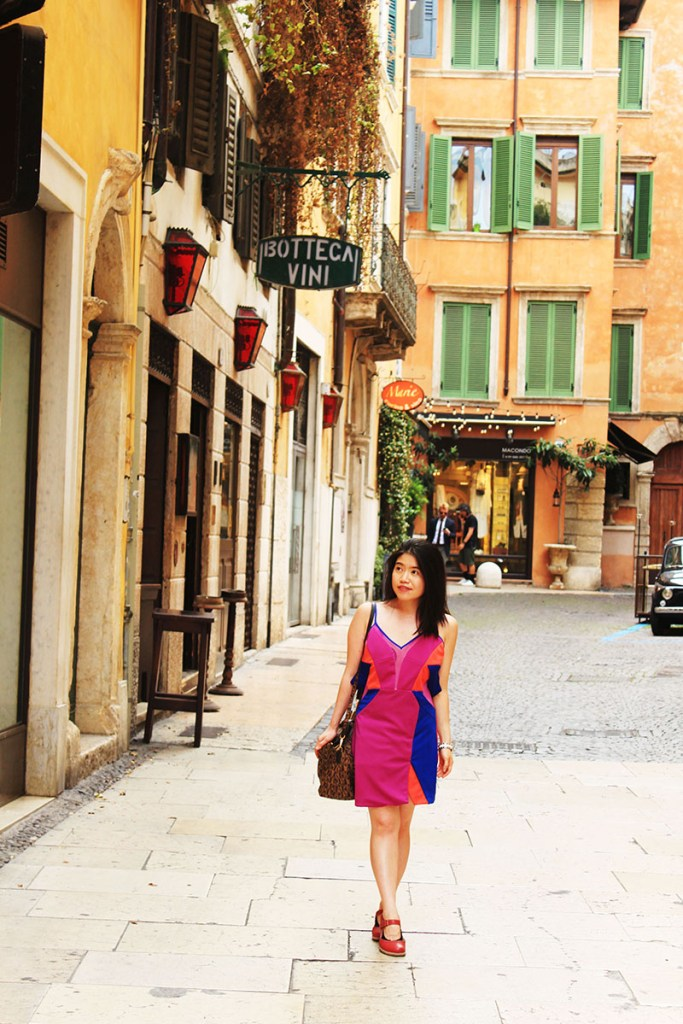 fashionable girl in a pink dress traveling verona
