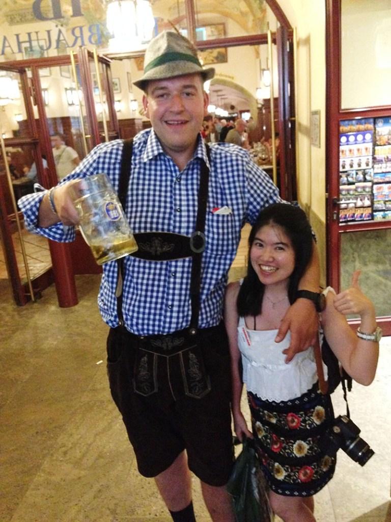 tall german man with short petite asian girl drink beer oktoberfest munich
