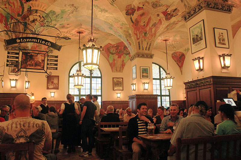 hofbrauhaus munich germany floral ceiling people drink beer oktoberfest