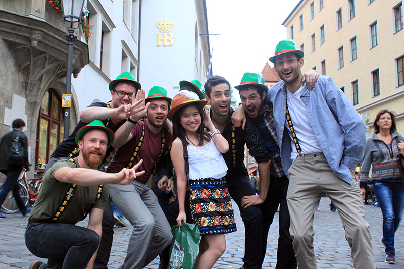 asian girl petite oktoberfest photo posing german guys green hats munich germany