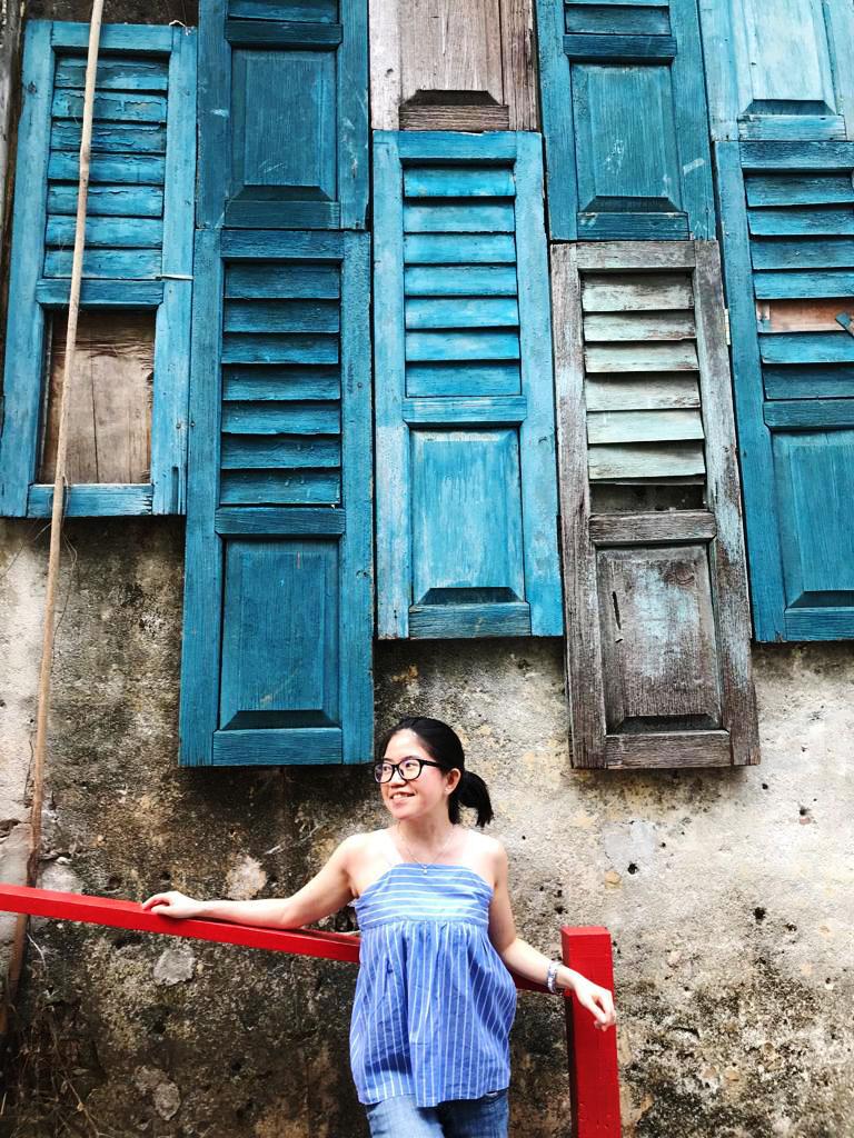 agirlnamedclara asian girl traveler posing blue vintage windows lorong panggung chinatown kl
