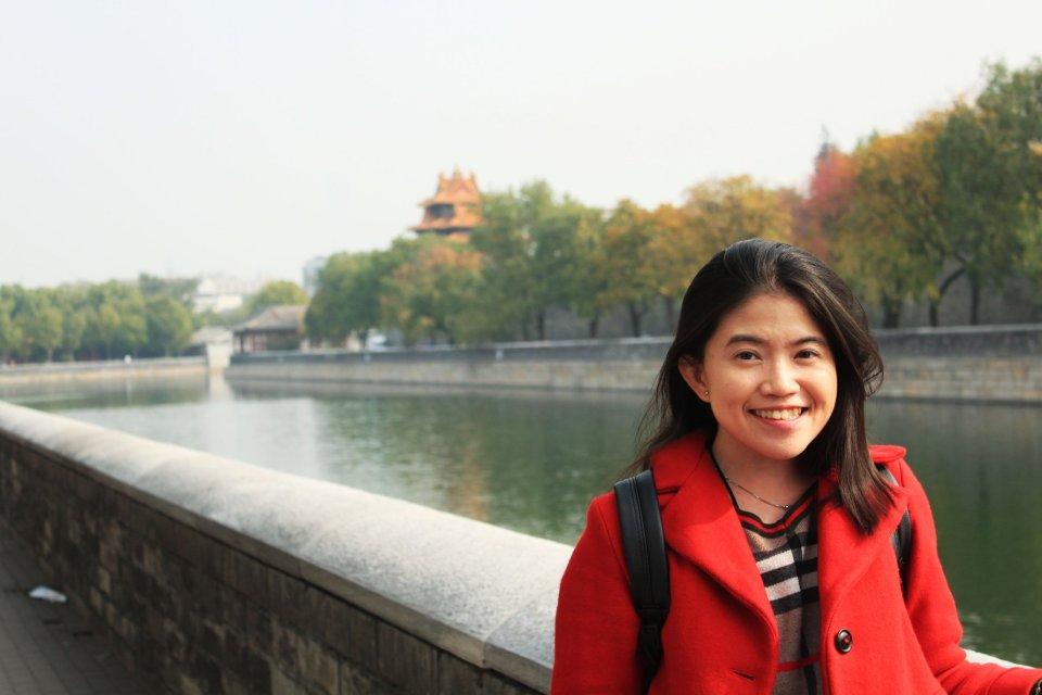 investment people overlooked agirlnamedclara female traveler tourist red coat smiling short hair beijing river background autumn fall season blogger