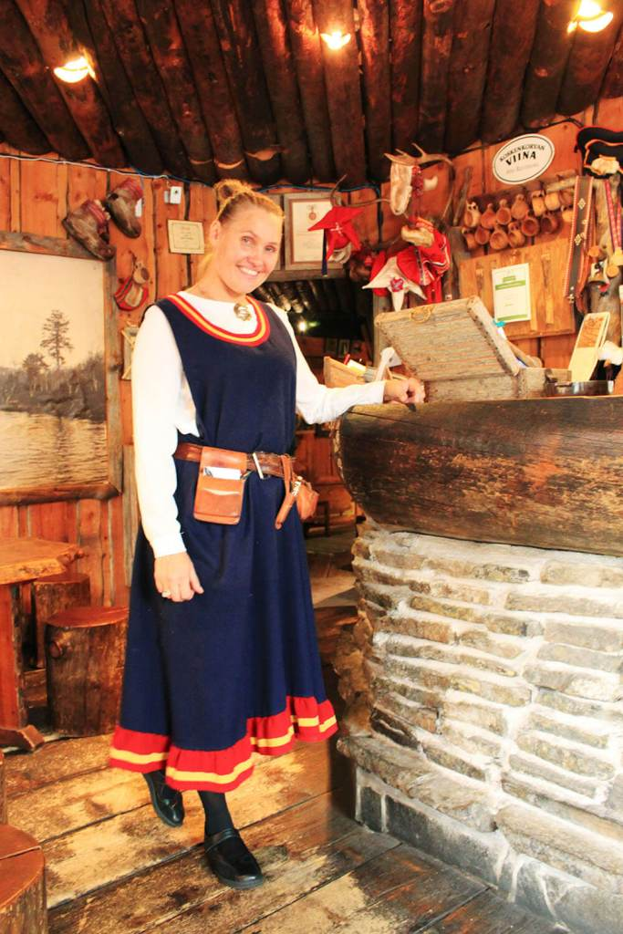 agirlnamedclara finland woman traditional dress clothes smiling lappi restaurant
