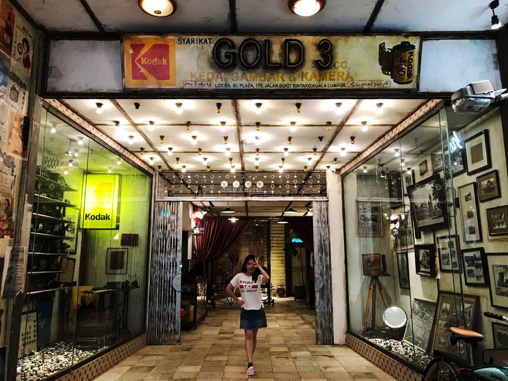 agirlnamedclara_camera museum gold3 hotel kl destination asian girl poses