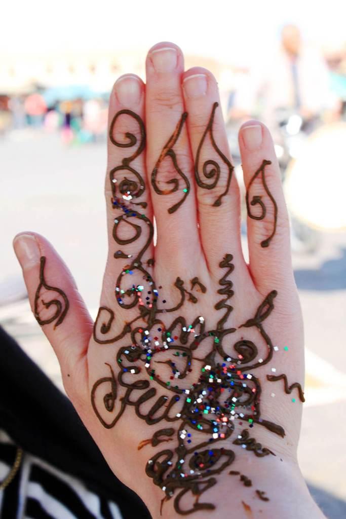 marrakech souk morocco henna hand art tourist trap