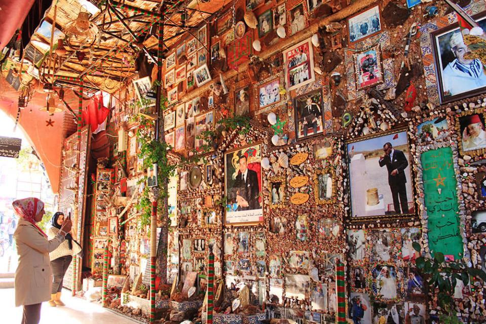tourist take photo of the wall tribute for moroccan king marrakech souk morocco agirlnamedclara