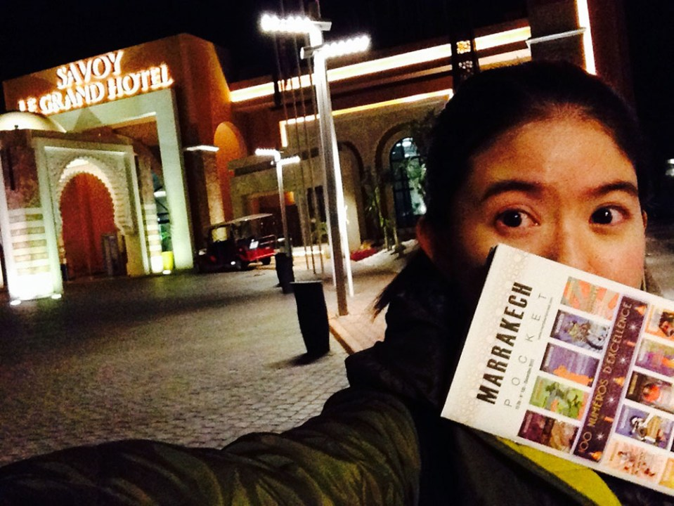 savoy hotel marrakech morocco night tourist female traveller holding marrakech leaflet brochure selfie