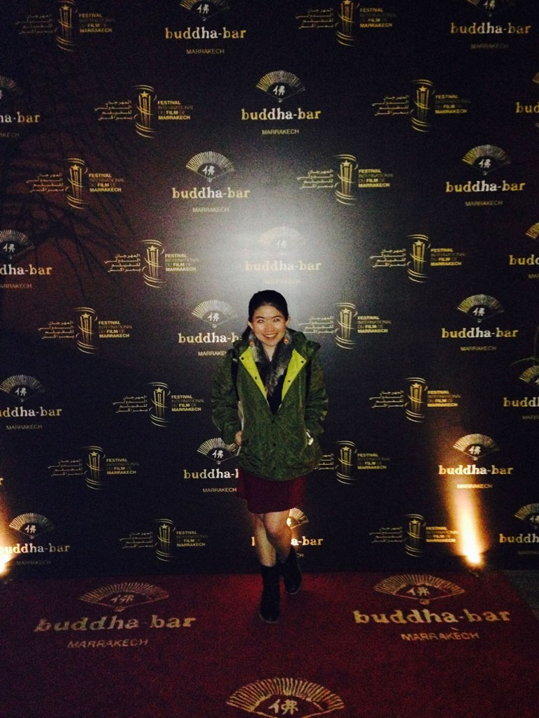 buddha bar marrakech morocco entrance red carpet black backdrop solo female traveler green downjacket