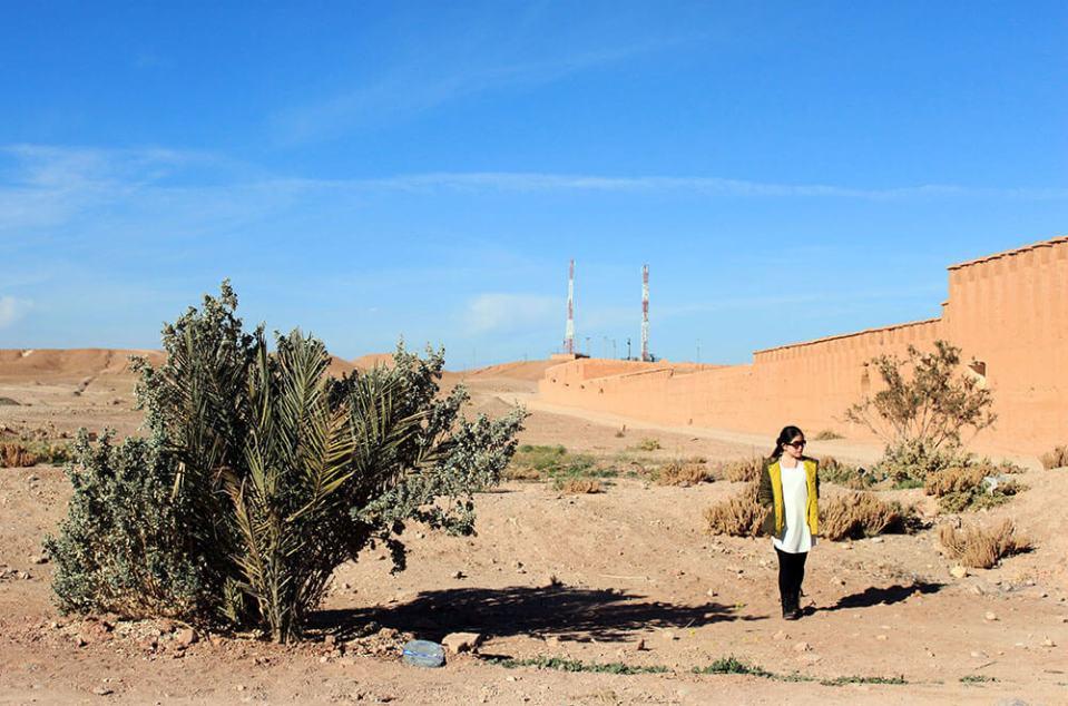 a girl white dress green jacket standing alone in savanna morocco blue sky background agirlnamedclara