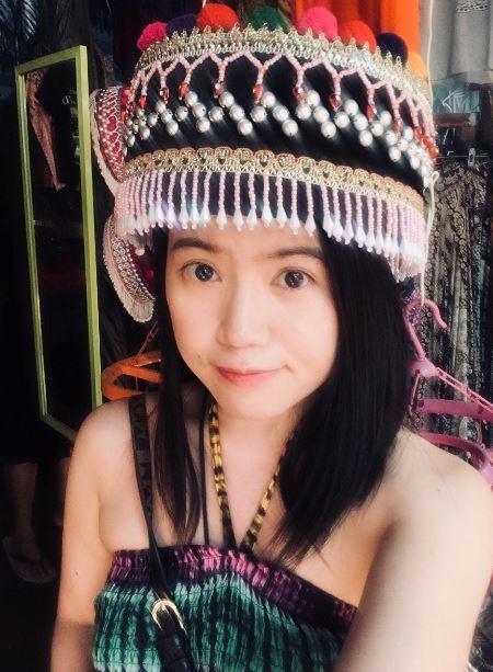 asian girl traveler tourist wearing traditional thai chiang mai headpiece colourful agirlnamedclara