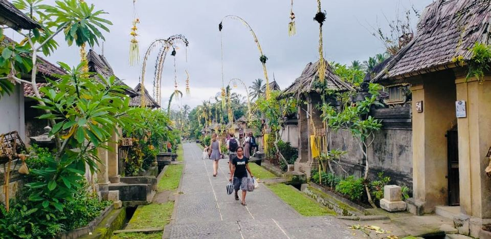 a local woman walking in desa penglipuran village bali bangli galungan agirlnamedclara