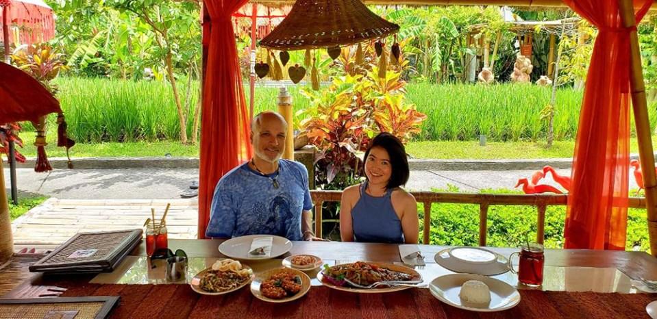 age gap couple smile lunch at mang engking bale udang ubud nature background bali agirlnamedclara