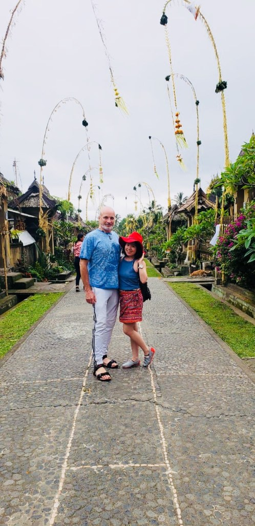 couple matching clothes smiling at penglipuran during galungan bali agirlnamedclara