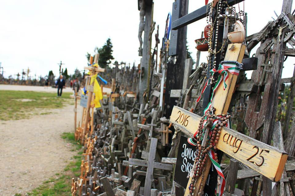 Wooden cross zoom in among hundreds of crosses at Hill of Crosses Lithuania_agirlnamedclara