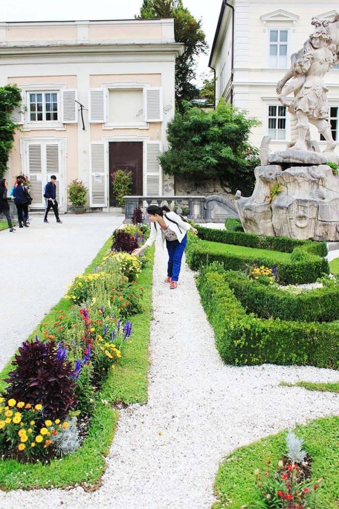 asian girl greets flowers sweet mirabell gardens salzburg austria_agirlnamedclara
