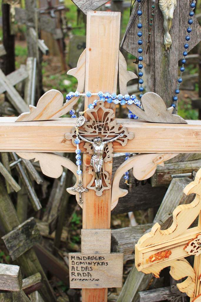 blue rose pattern rosary on wooden cross Hill of Crosses Lithuania Happy Easter_agirlnamedclara