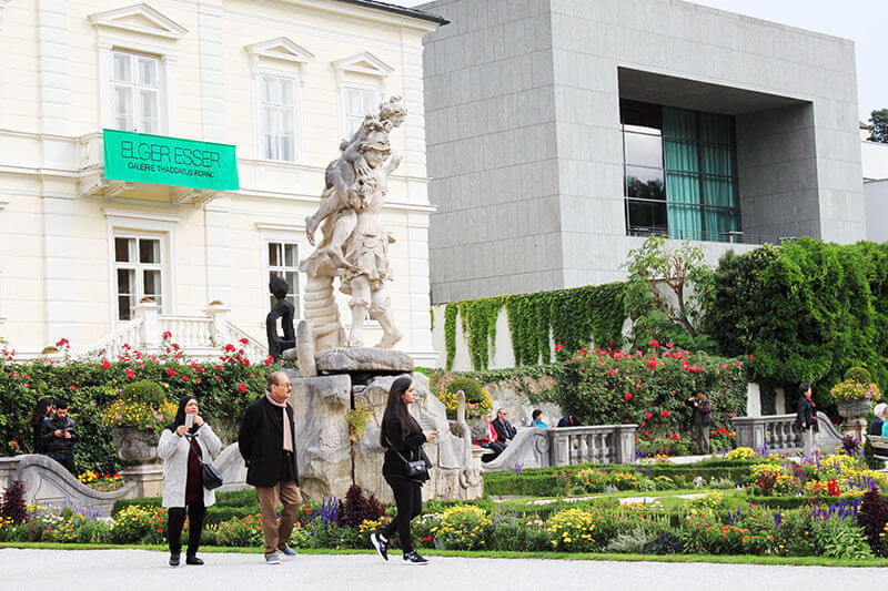 tourists walking in mirabell garden building background salzburg austria_agirlnamedclara