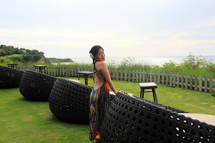 asian girl flower on ear bare back dress pose bali green sea background ayana resort and spa_agirlnamedclara