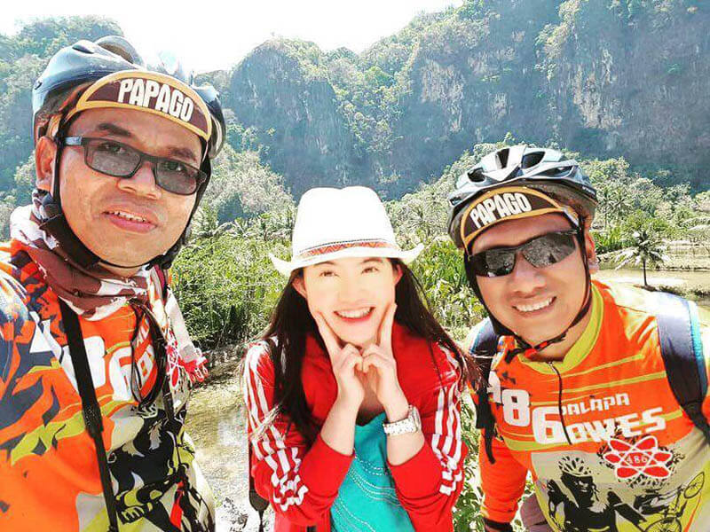 cyclist and travel girl smiling mountain background nature bukit rammang rammang makassar toraja_agirlnamedclara