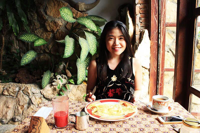 girl long hair smile traveler tourist breakfast pias poppies hotel toraja makassar_agirlnamedclara