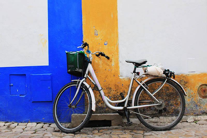bicycle blue yellow white wall background obidos agirlnamedclara