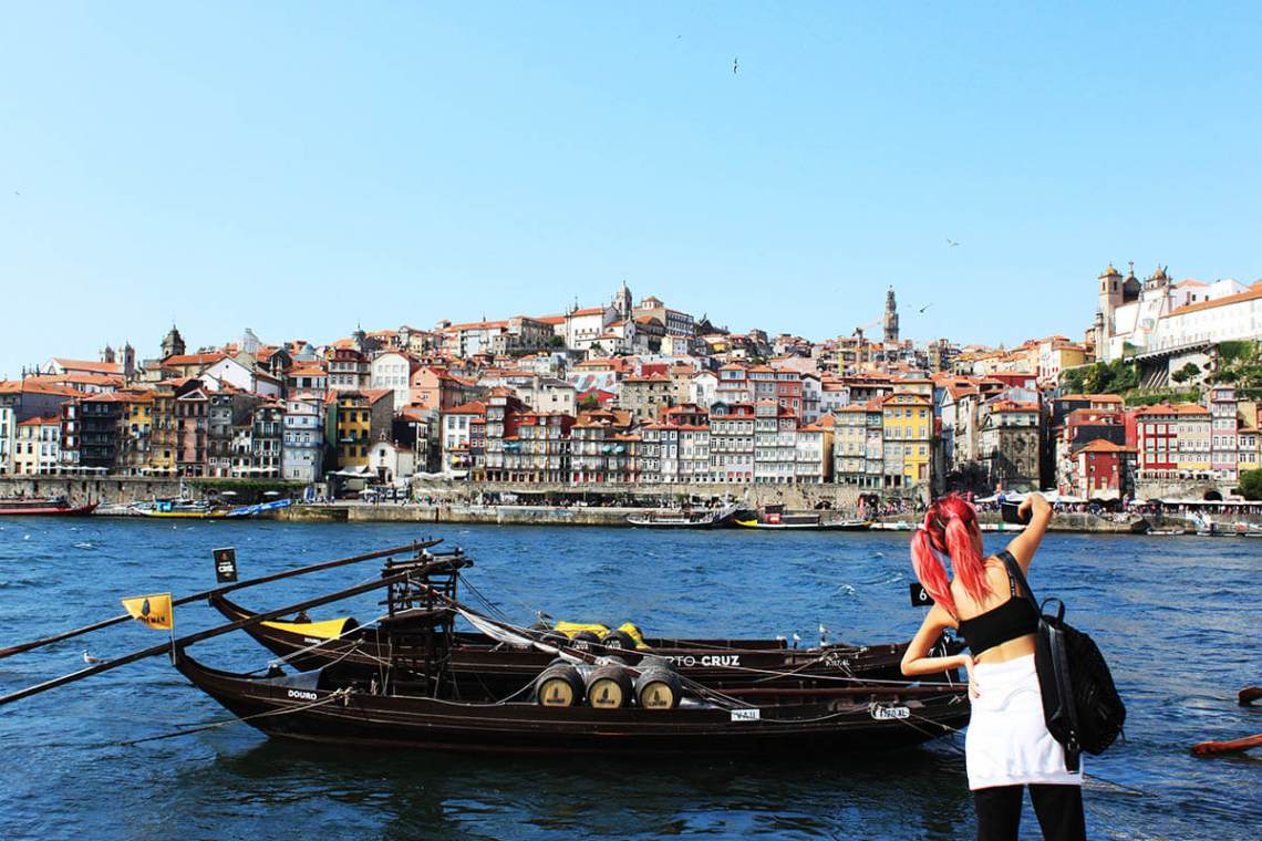 pink hair girl traveler tourist take photo of ship building sea porto portugal agirlnamedclara