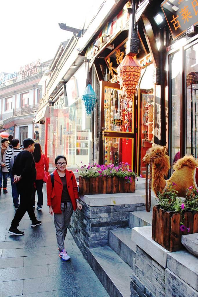 girl tourist red coat in front of a shop in houhai beijing china agirlnamedclara