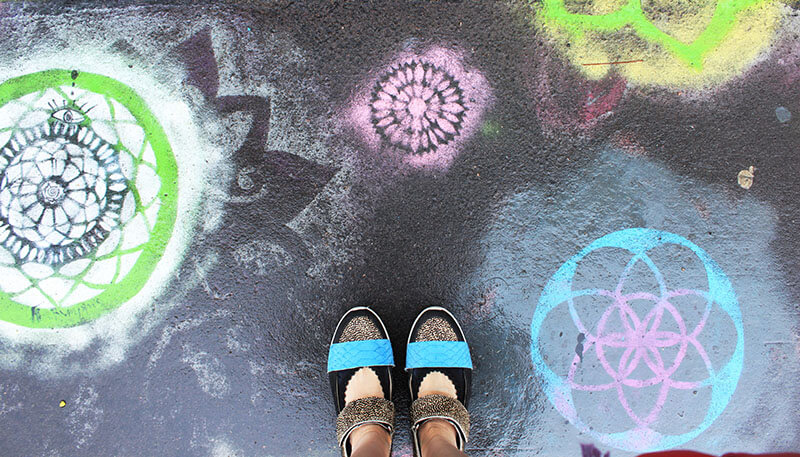 girl shoes stand on colorful grafitti on the street art helsinki finland agirlnamedclara