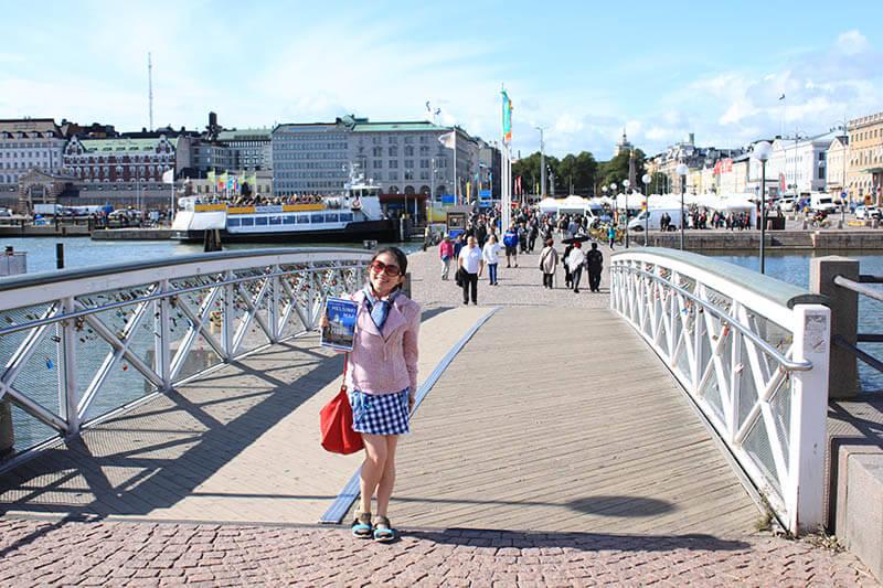 girl smile holds tourist map helsinki finland bridge agirlnamedclara