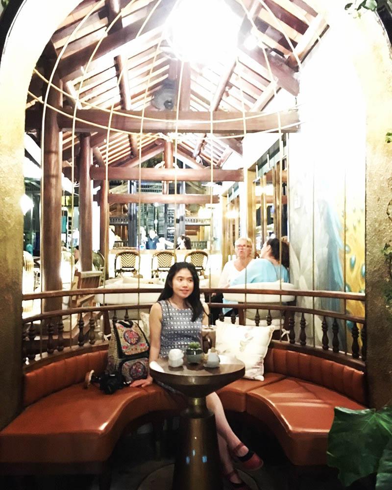 asian girl smile holds iced chocolate bird house cafe hoi an agirlnamedclara