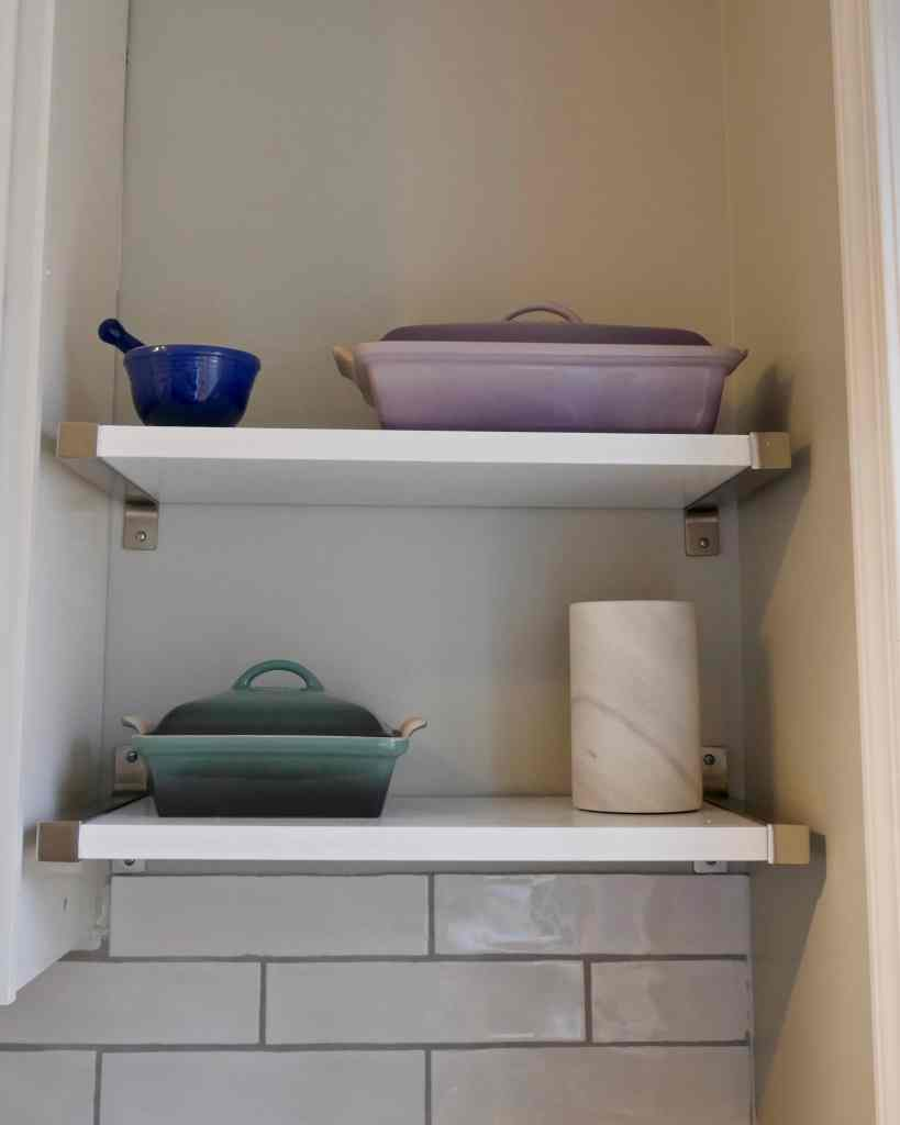 painted white shelves with ceramic ware