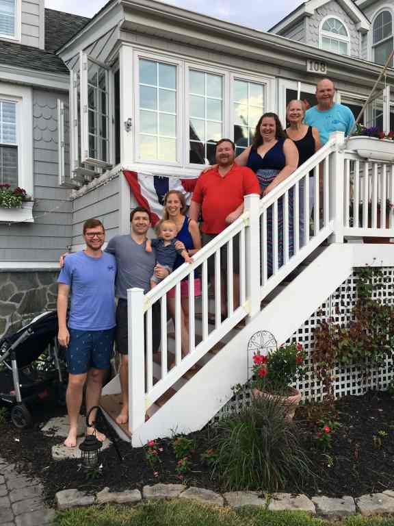 family pic on the beach house stairs