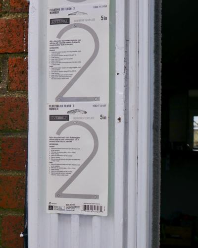 Hanging the guide for new address numbers