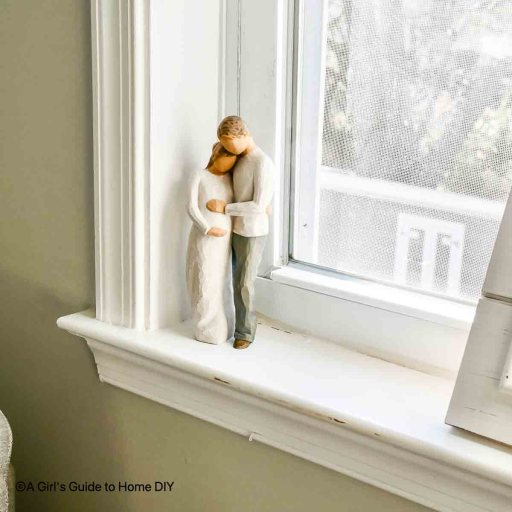pregnant woman and man figurine