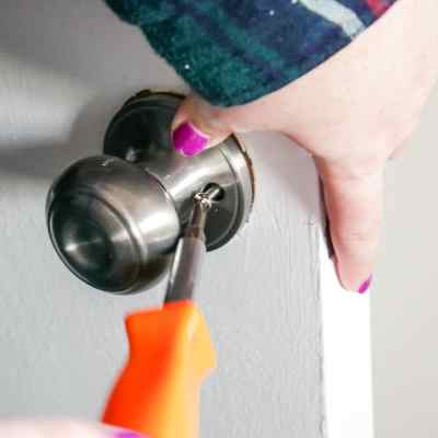 removing the rose of the door knob