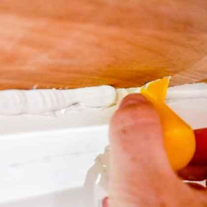 smoothing the caulk