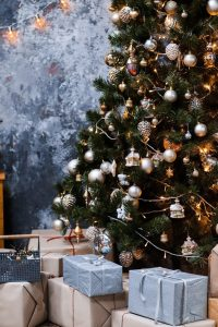 christmas presents under christmas tree blue and silver colour scheme