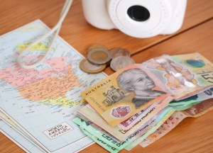 Foreign currency, a camera, and travel maps