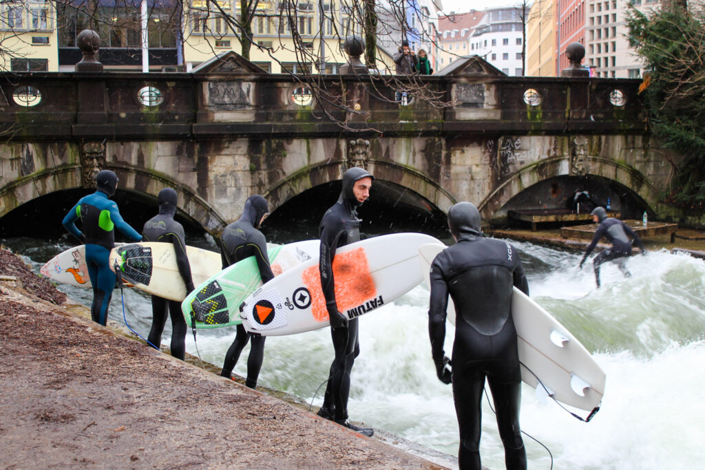 Canal surfers at the English Garden in Munich, Germany