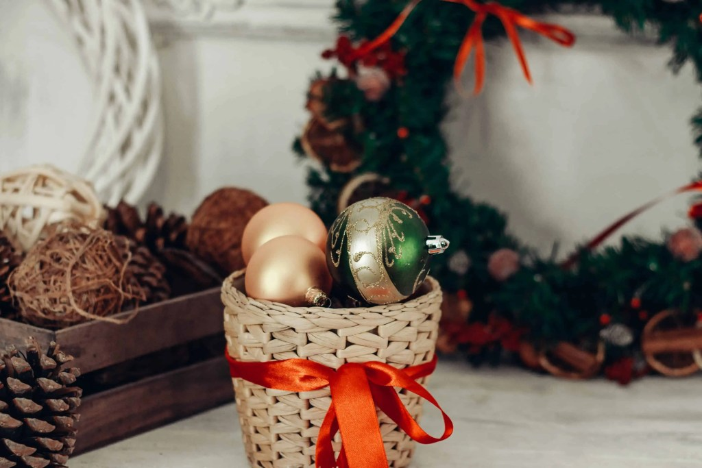 Christmas bauble decorations in a wicker basket