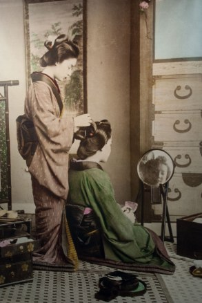 An 1890 photograph of a Japanese lady having her hair dressed.