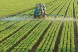 farming tractor spraying a field regulation