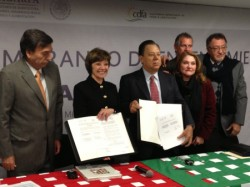 CDFA Secretary Karen Ross (second from left) at today's signing with representatives of the Mexican agricultural agency SAGARPA and the USDA's Foreign Agricultural Service. (Photo courtesy of CDFA)