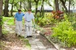 son walking with senior father