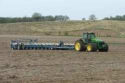 John Deere 8530 tractor with Kinze 3700 planter