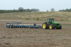 John Deere 8530 tractor with Kinze 3700 planter