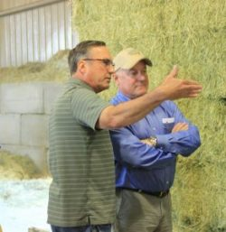 Bothers, Gary and Vernon Frederickson, are first generation owners and operators of Oregon Hay Products in Boardman. Gary (left) and Administrator Dolcini (right) discuss how the hay is stored and shipped in containers to export partners overseas.