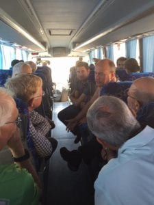 The delegation discusses water and climate change on the bus to the Negev Desert